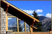 Large windows and decks offer great mountain views